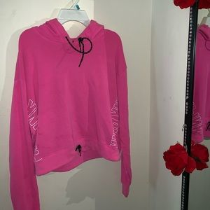 Hot Pink PINK Crop Top Hoodie with drawstrings.
